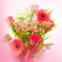 Celebratory blossom of roses and lily and gerbera