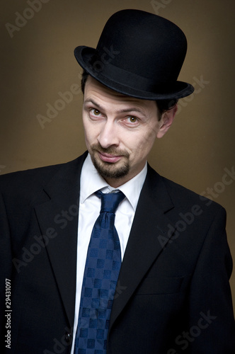looking from businessman with bowler