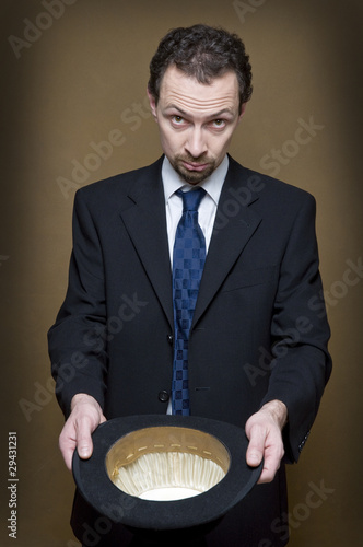 begging businessman with bowler