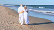 Seniors Walking Barefoot on the Beach filmed at 60FPS