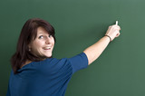 Women Teacher at the backboard