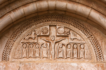 Christ crucified, tympanum of the church of Santa Maria,Siurana