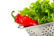 Pepper and lettuce in a colander