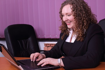young woman with a laptop