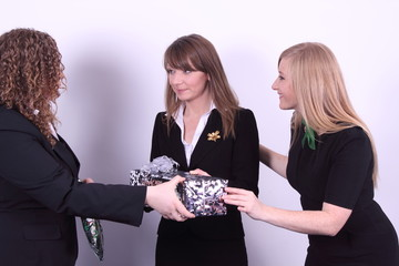 business women with gifts