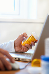 Doctor preparing online internet prescription drugs