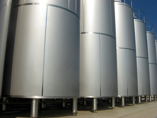 silos containing liquid inside a factory