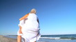 Mature Couple Piggyback Beach Fun filmed at 60FPS