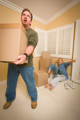 Stressed Man Moving Boxes for Demanding Wife