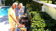 Senior Couple Grilling Healthy Food on Barbeque
