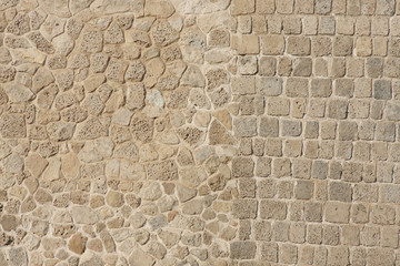 Two different patterns in wall of limestone and coral blocks