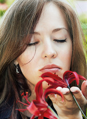 woman smelling lily