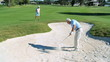 Senior Gentleman Chipping Ball out of Sand Bunker