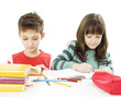 Young girl and boy doing their homework on the desk