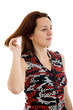 Young girl combing her hair