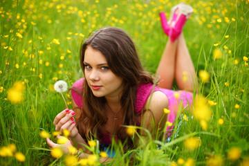 woman blow on dandelion