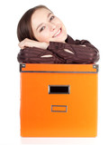 smiling young woman with big orange box