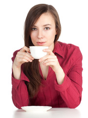 serious young woman with cup, drinking coffee or tea