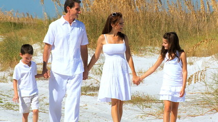 Loving Young Family on the Beach filmed at 60FPS