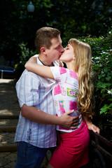 Romantic kiss of happy lovers
