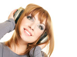 Smiling beautiful woman with headphones isolated over a white