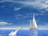Sailing luxury yacht and bottle with letter