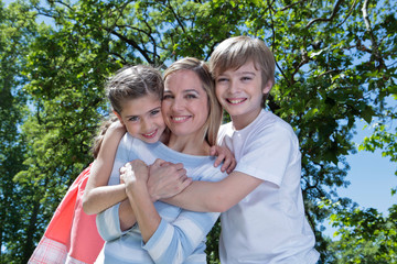 Happy mother with her children