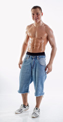 Muscular boy in jeans shorts