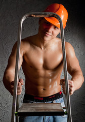 Muscular Man in Building helmet