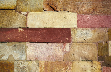 Reddish stone brick wall texture
