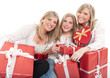 Three beautiful sisters with presents