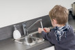Child washing his hands