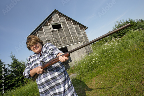 Woman with huge rifle