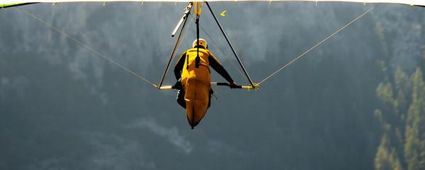 Hang-gliding over a valley