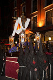 Nazarenos and Holy Cross in Semana Santa procession. Valladolid