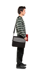 Full length portrait of a student with a bag standing in line