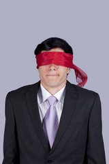 blindfold businessman