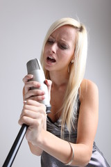 portrait of a girl with a microphone