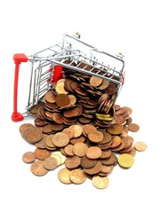 A shopping trolley with coins lying on a white background
