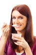 Portrait of young happy woman eating yoghurt, isolated
