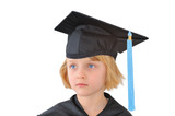 Portrait of cute little girl in graduation dress