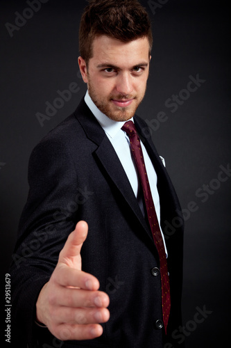 Businessman giving hand