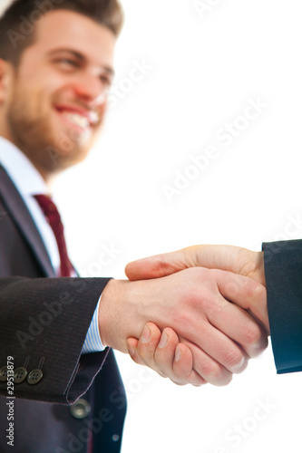 Two businessmen giving hands isolated on white