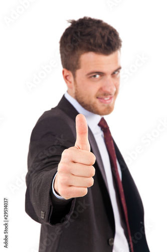 Businessman making all right gesture isolated on white