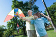 Grandfather and grandson with a kite