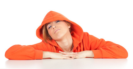 woman in orange sweatshirt with hood on head