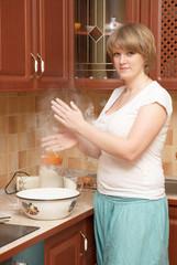 A pretty girl preparing pancakes