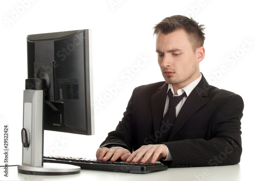 young man in black suit working on computer