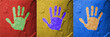 Red Yello Blue hand prints on stone