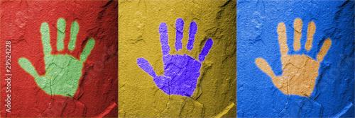 Red Yello Blue hand prints on stone